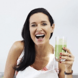 Image of Amanda Brocket laughing while holding a green juice