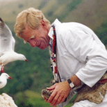 Image of James Mills holding a seagull chick